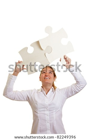 Two fitting big oversized jigsaw puzzle pieces - stock photo