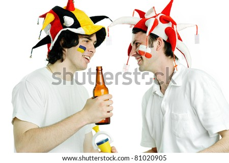 Two football fans with beer shooting in studio - stock photo
