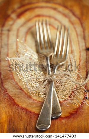 two fork tied by string on old wood, selective focus, shallow dof - stock photo