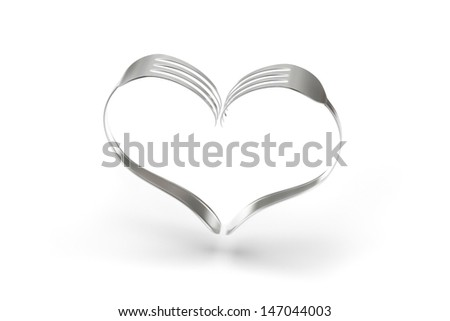 Two forks forming a heart isolated on a white background. - stock photo