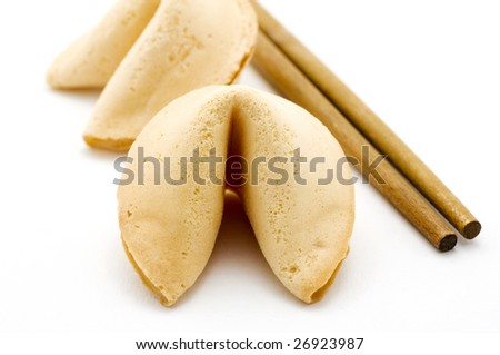 Two fortune cookies on white with brown chopsticks - stock photo