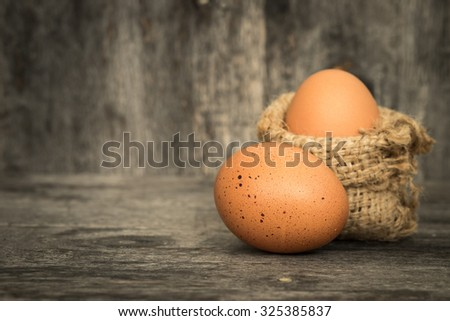 Two fresh eggs on wooden background  - stock photo