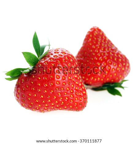 two  fresh red strawberries with leaves - stock photo