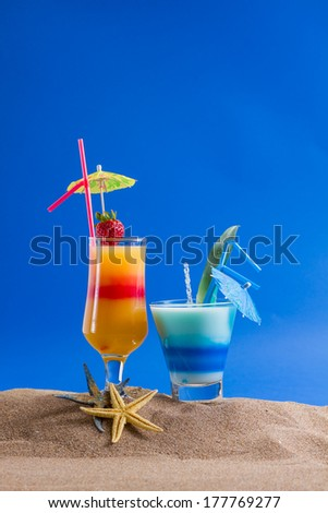 two Fresh tropical cocktail on beautiful sunny beach - stock photo