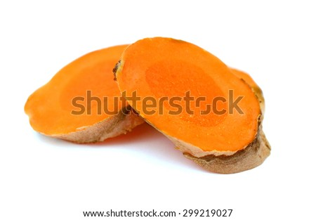 two fresh turmeric slices on white - stock photo