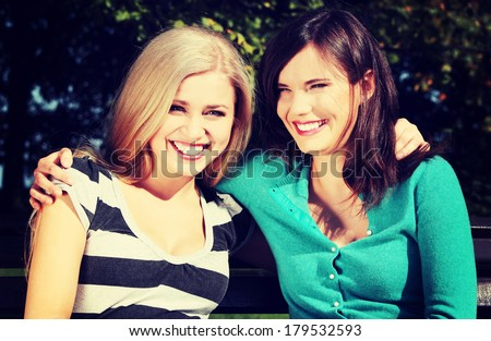 Two friended women at park - stock photo