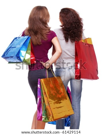 Two friends from the back with shopping on a white background - stock photo