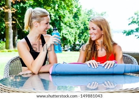 two friends laugh and rest - stock photo