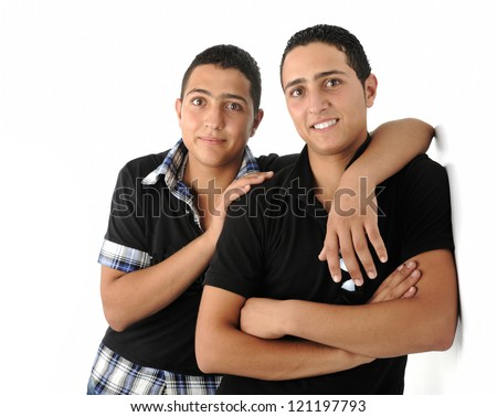 Two friends leaning against the wall isolated - stock photo