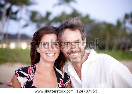Two friends  / lovers /partners on the beach - stock photo