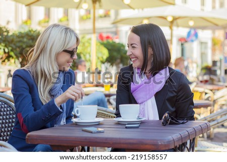 Two friends meeting for a coffee - stock photo