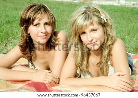 two friends on a meadow - stock photo