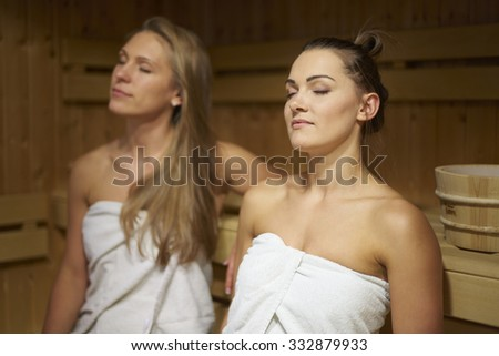 Two friends relaxing in sauna  - stock photo