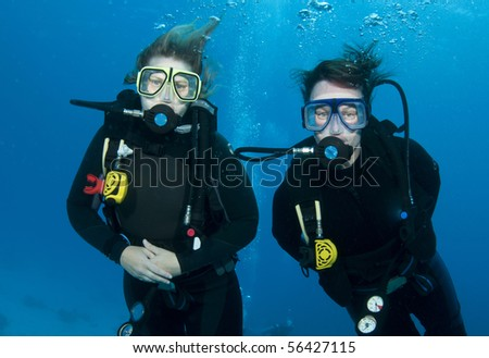 two friends scuba diving together - stock photo