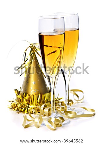 Two full champagne flutes with party hat and ribbon isolated on white background - stock photo