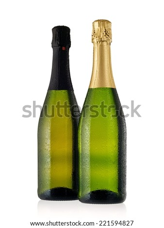 Two full green champagne bottles with drops - stock photo
