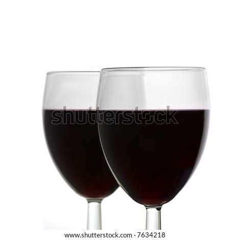 Two Full Wine Glasses with Focus on Closest Glass with Copy Space - stock photo