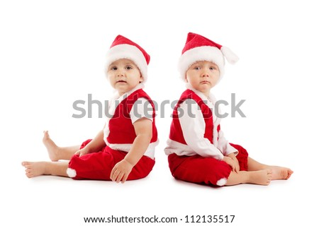 two funny boys in christmas costumes - stock photo