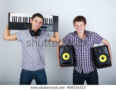two funny boys with speakers and piano - stock photo