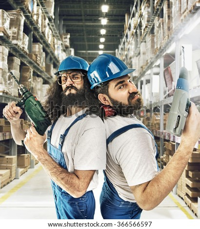 Two funny craftsmen - stock photo