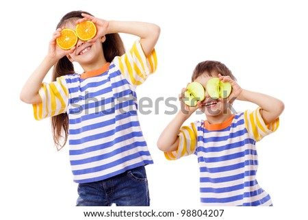 Two funny kids with fruits on face, isolated on white - stock photo