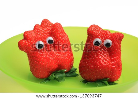 two funny strawberry characters with jiggle eyes - stock photo