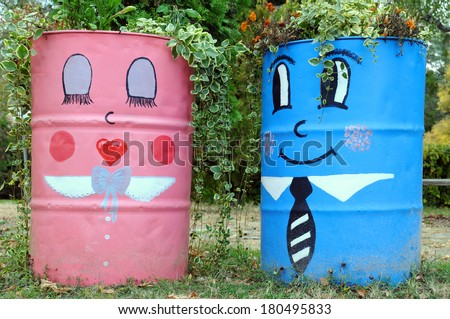 Two funny street planters in the park in Bulgaria - stock photo