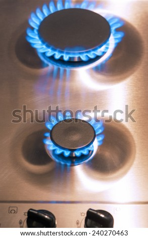 Two Gas Burners with Regulator Valves on Stove Surface. Vertical Image - stock photo