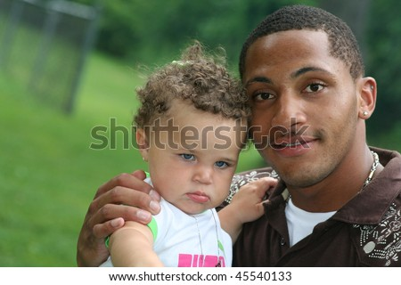 Two Generation Family African American Man with toddler Hot Summer Day - stock photo