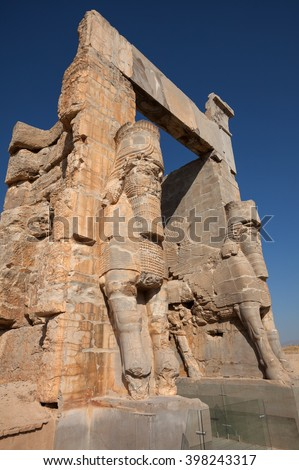 Two giant Lamassus giarding the Gate of All Nations in the ruins of ancient Persepolis, capital of Achaemenid Empire in Shiraz, Iran. - stock photo