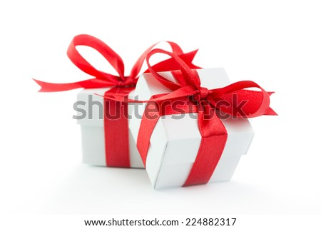 Two gift boxes with red ribbons on white background - stock photo