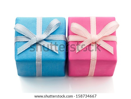 Two gift boxes wrapped in different colored paper, blue and pink - stock photo