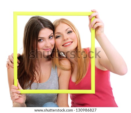 Two girl friends smiling isolated on white - stock photo