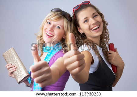 two girlfriends having fun show gesture ok - stock photo