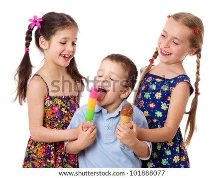 Two girls are feeding a little boy with ice cream, isolated on white - stock photo