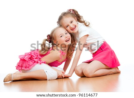 Two girls are playing together. Isolated over  white background - stock photo