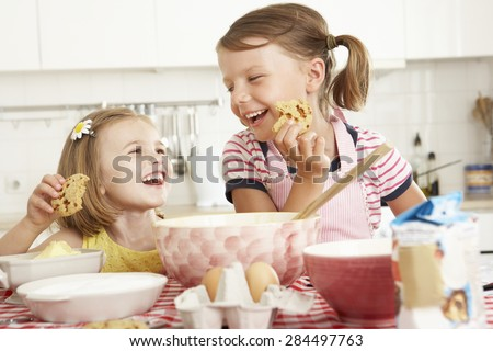 Two Girls Baking In Kitchen - stock photo