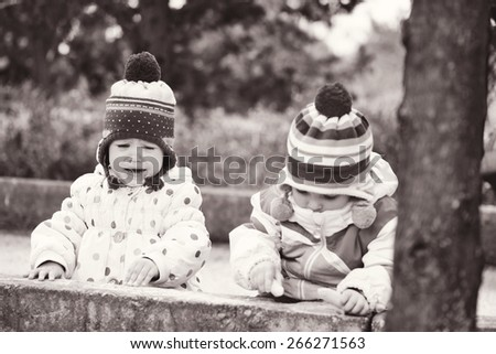 two girls can not share toys on the walk - stock photo