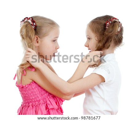 Two girls fighting over  white background - stock photo
