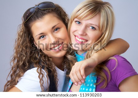 Two girls girlfriends having fun together - stock photo