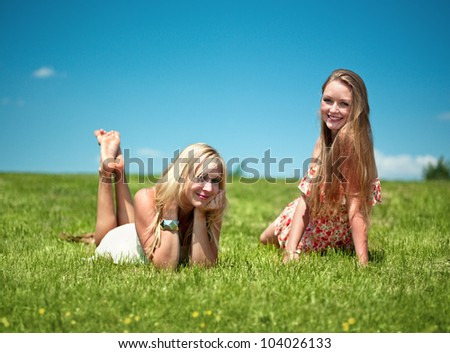 two girls have nice day in nature, smiling into the camera - stock photo