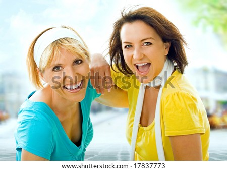 two girls having fun in the city.  A keyword for this collection is wima7 - stock photo