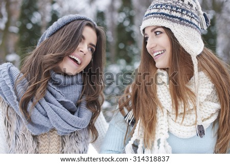 Two girls having fun outdoors in the winter - stock photo