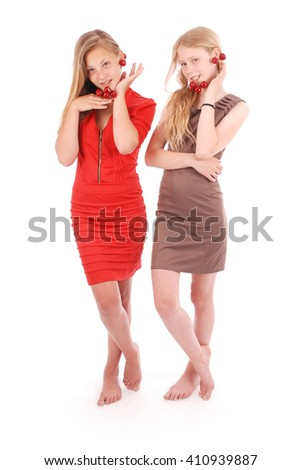 Two girls hold in lips fresh cherries isolated on white - stock photo