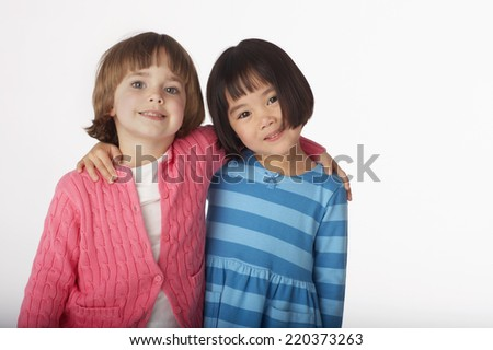 Two girls hugging - stock photo