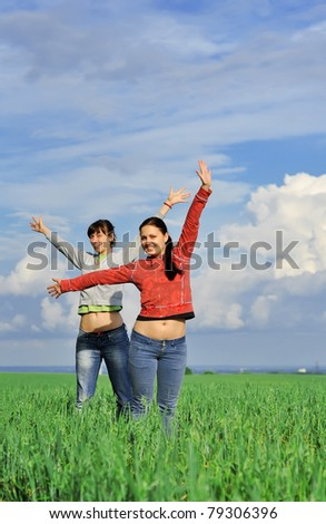 Two girls in a field - stock photo
