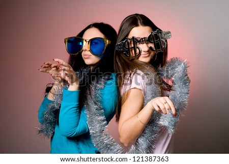 Two girls in the big fancy glasses. - stock photo