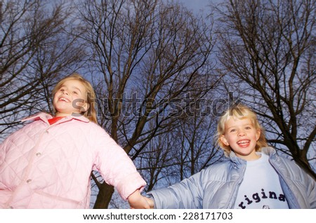 Two girls in the open - stock photo