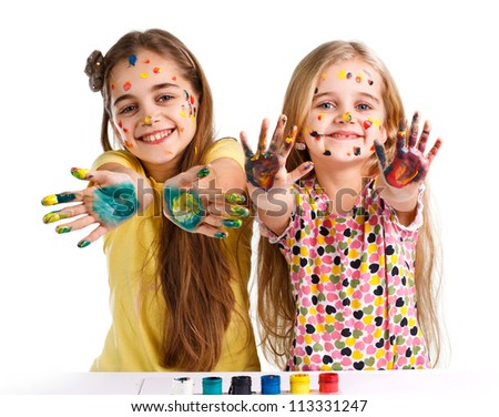 two girls painted with colorful paint - stock photo