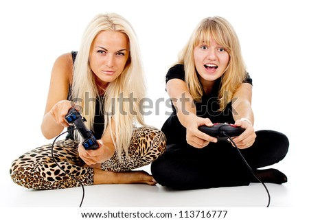 two girls play video games isolated on white background - stock photo